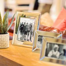 Silver Picture Frames on Living Room Console Table