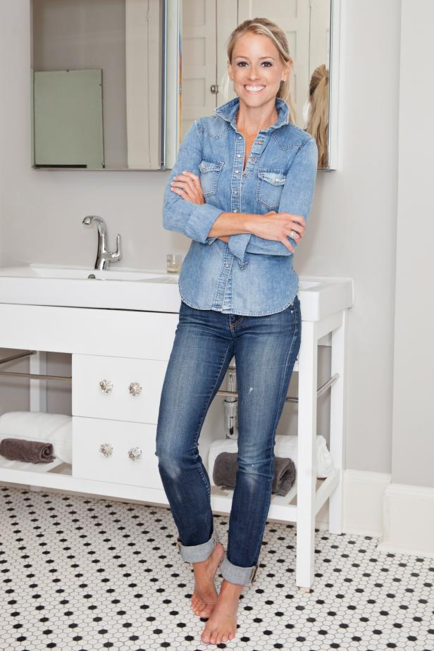 Nicole Curtis Standing in a Bathroom