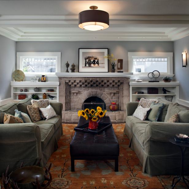 Gray Living Room With Stone Fireplace, Sage Sofas & Orange Rug