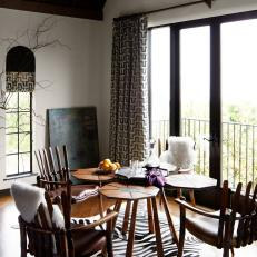 Eclectic Dining Room With Zebra Rug