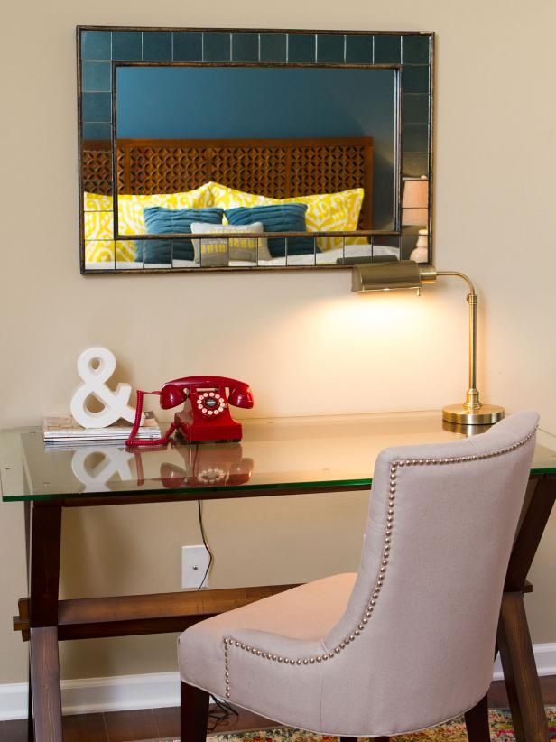 Glass Desk With Ivory Upholstered Chair and Rectangular Mirror