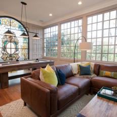 Contemporary Living Room With Arched Stain Glass Window