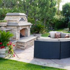 Outdoor Fireplace With Contemporary Curved Sofa