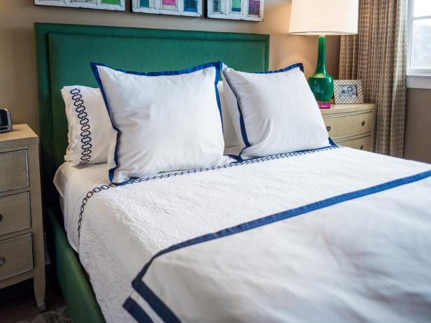 Green Headboard, Green Lamp and White Duvet With Blue Embroidery