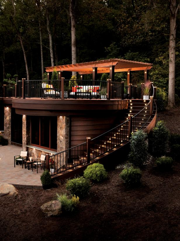 Staircase With Lights Leads to Outdoor Living Area With Pergola