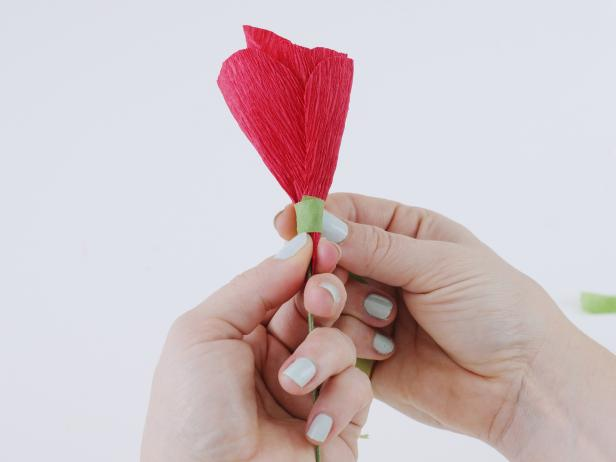 Secure the petals with a strip of floral tape. Arrange the outer petals by overlapping each one, and secure with floral tape. Wrap the floral tape all the way down to the wire to create a seamless look.