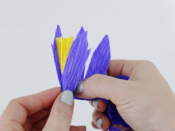 Wrap the petals around the stamen, crimping and pleating as you go.