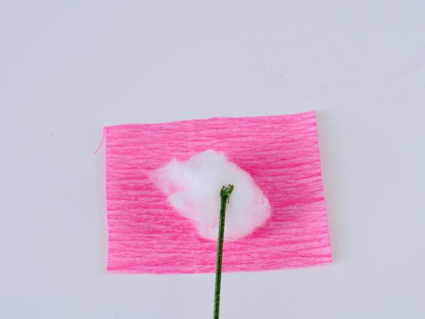 To make the peony, roll a medium-sized piece of cotton into a ball. Cut a 2x2-inch piece of pink crepe paper.