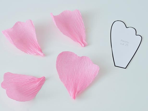 Use your fingers to stretch apart the crepe paper folds along the top of each petal to make them look more realistic.