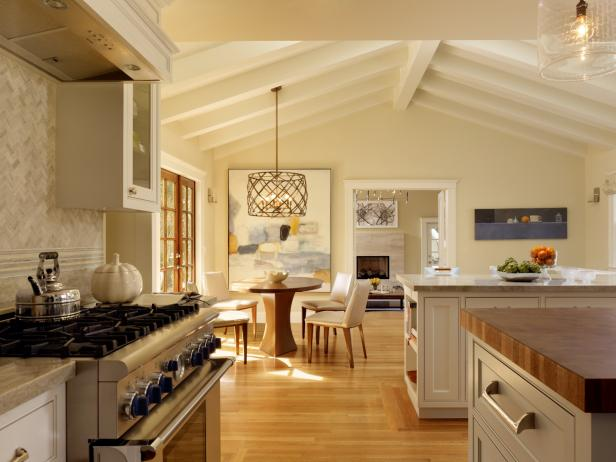 White Eat-in Kitchen with Beamed Ceiling and Marble Countertops