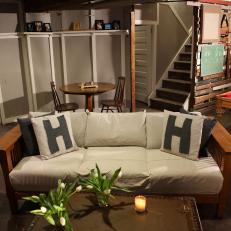 Basement Sitting Area With Cozy Vintage Sofa