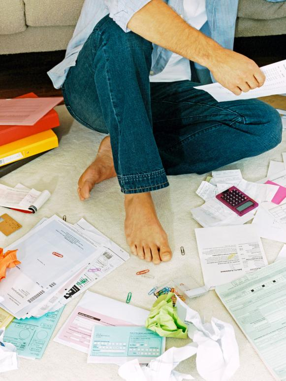 Man With Mess of Papers and Bills