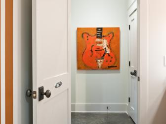 White Hallway With Concrete Floors and Burnt Orange Accents