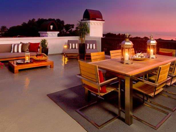 Mediterranean Roof-Top Patio With Wooden Furniture