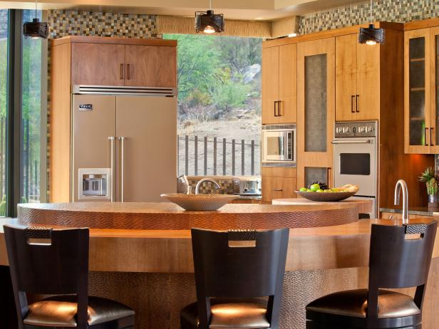 Neutral Kitchen With Pale Cabinetry, Curved Island, Mosaic Tile Border