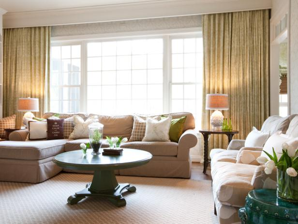 Living Space With Large Windows and Neutral Furnishings