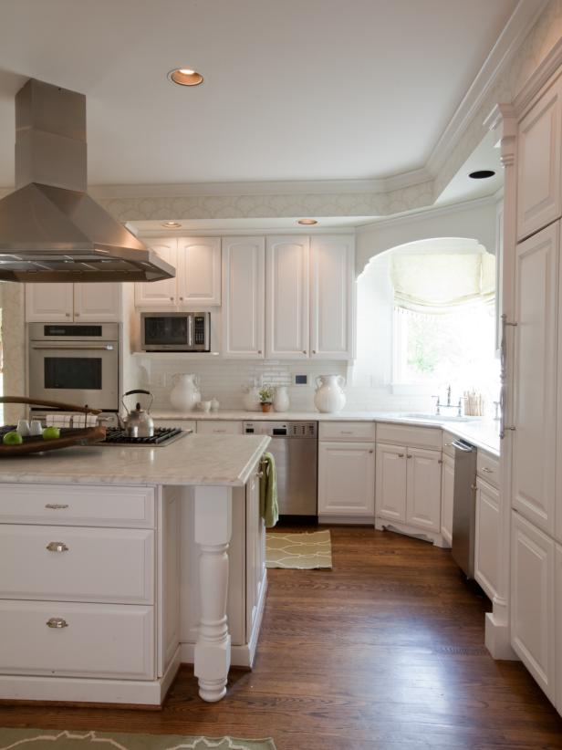 White Kitchen with Furniture-Style Cabinets and Stainless Steel Hood