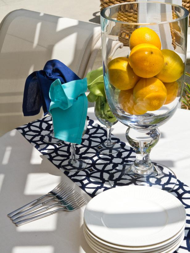 Outdoor Living Space With Blue, Orange and Green Table Setting