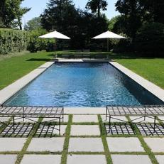Classic Grass-and-Paver Path to a Swimming Pool