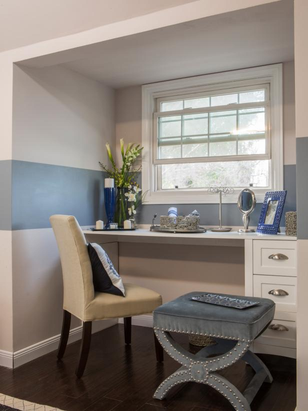 Dormer Nook With Built-In White Vanity, Neutral Chair and Blue Ottoman