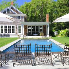 Wrought-Iron Chaises Gathered Around a Pool in a Cape Cod Home