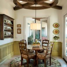 Circular Dining Room Has Rustic Charm With Porch View