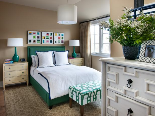 Neutral Bedroom With Green Bed, White Bedding and White Pendant Light