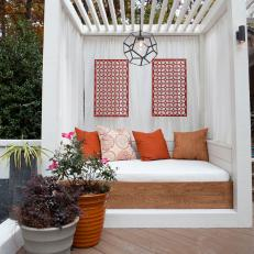 Relaxed Outdoor Daybed Under Contemporary Pergola