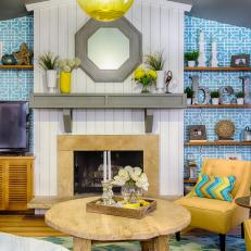 Living Room With Blue Wallpaper and Yellow Accents