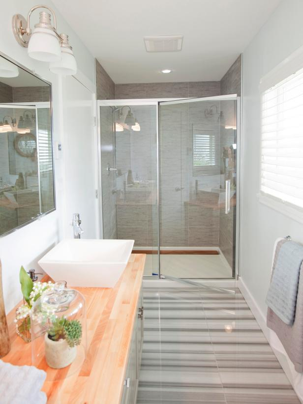 Bathroom With Glass Shower Door, Wood Countertop and White Vessel Sink