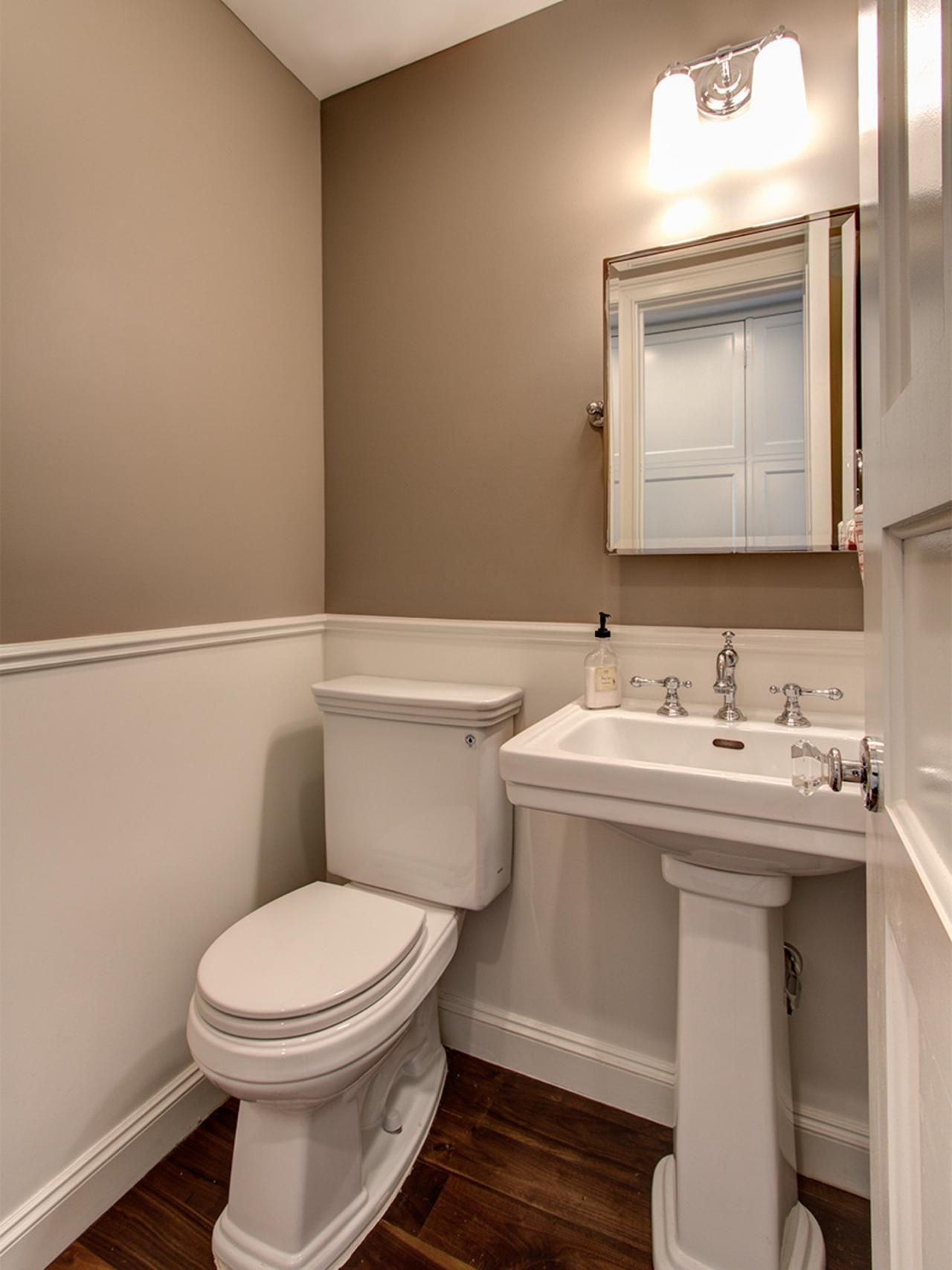 Small traditional powder room with wainscot hgtv - Bathroom remodel ideas with wainscoting ...