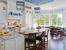 Sunny Kitchen With Contrasting Quartzite and Walnut Counters