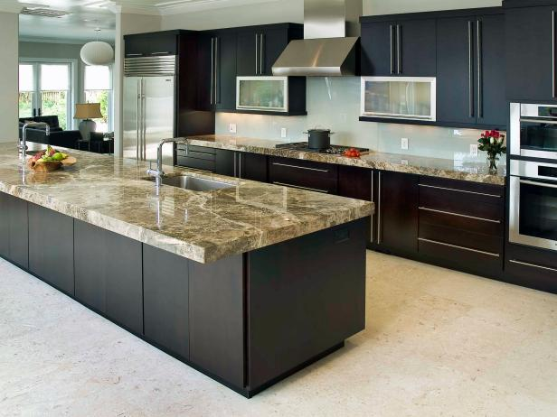 Gray Kitchen With Black Cabinets and Gray Marble Countertops