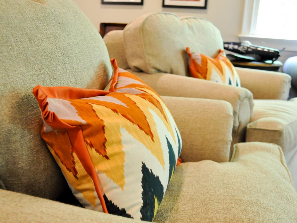 Orange Chevron Pillow in Neutral Chair