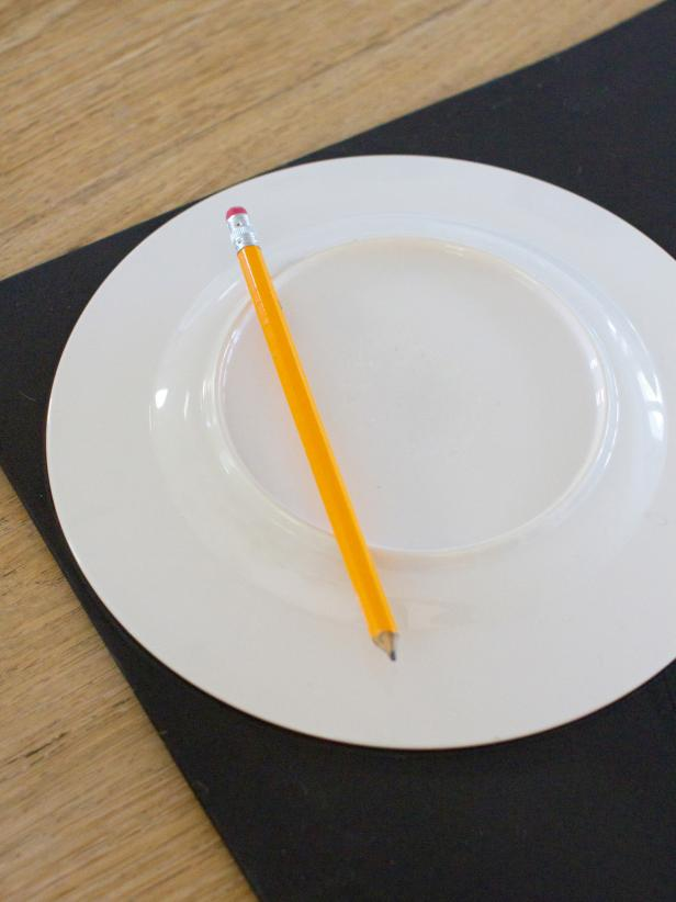Place a salad plate on top of a sheet of black craft foam, trace around it with a pencil then cut out the circle with a pair of scissors.