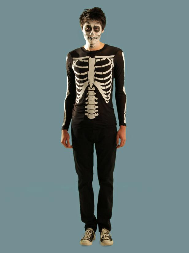 Finish your skeleton look with a skeleton T-shirt and dark jeans. The simple outfit paired with the makeup makes a great costume.