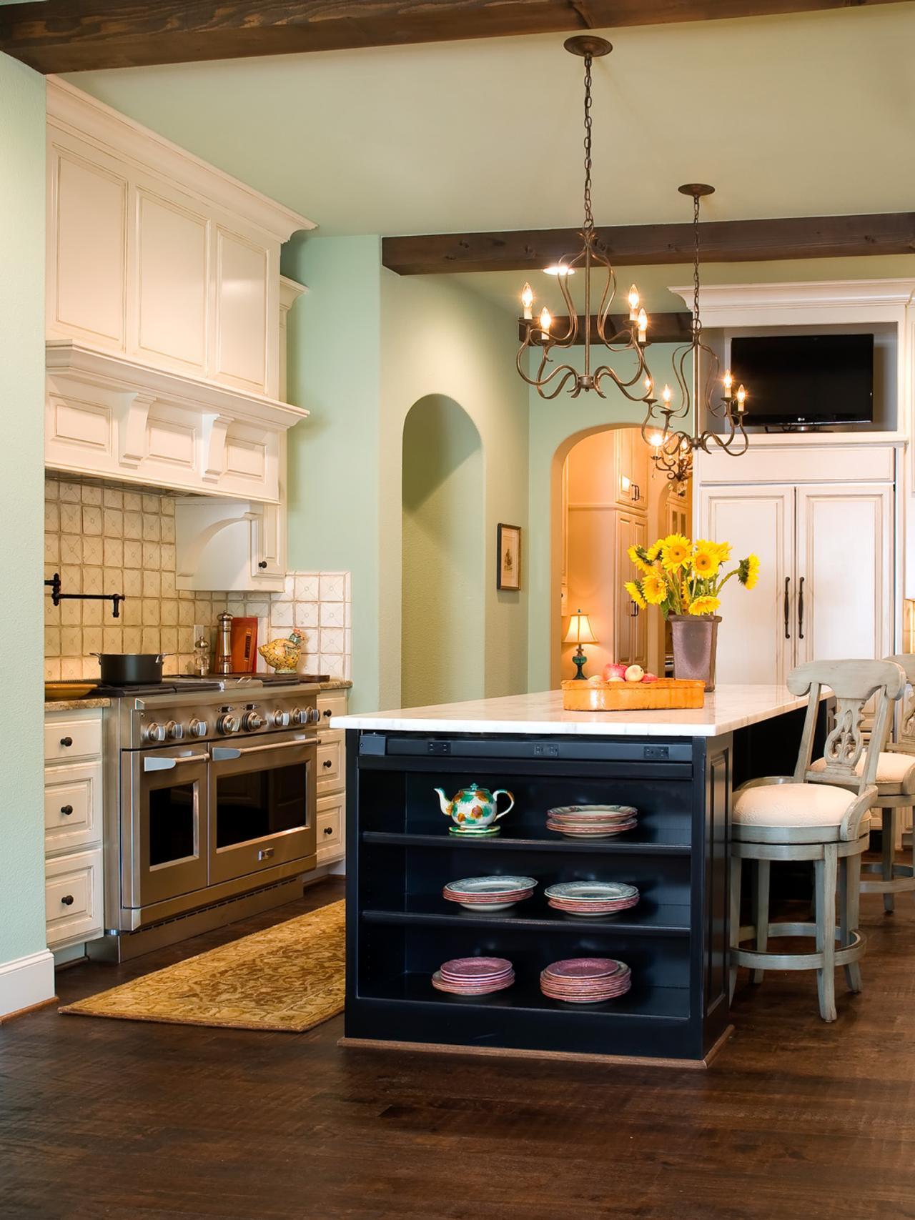 Soft Green Mediterranean Inspired Kitchen With White Cabinets