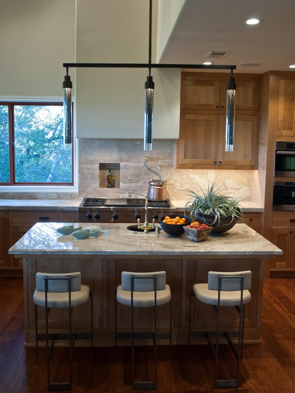 Contemporary Kitchen With Natural Countertops and Wood ...