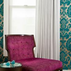 Posh Sitting Area with Pink Chair and Damask Wallpaper