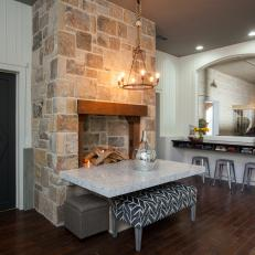 Casual Dining Space With Stone Fireplace