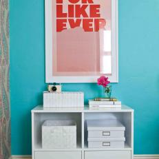Turquoise Bedroom With Red Poster and White Cabinet