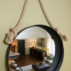 Round Hanging Mirror Reflecting Great Room