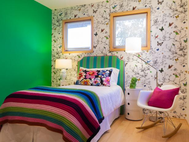 Colorful Girl's Bedroom With Wallpaper Accent Wall and Eames Rocker