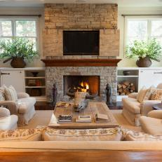 Transitional Neutral Living Room With Rustic Accents and Stone Fireplace