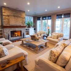 Transitional Living Room With Stacked-Stone Fireplace