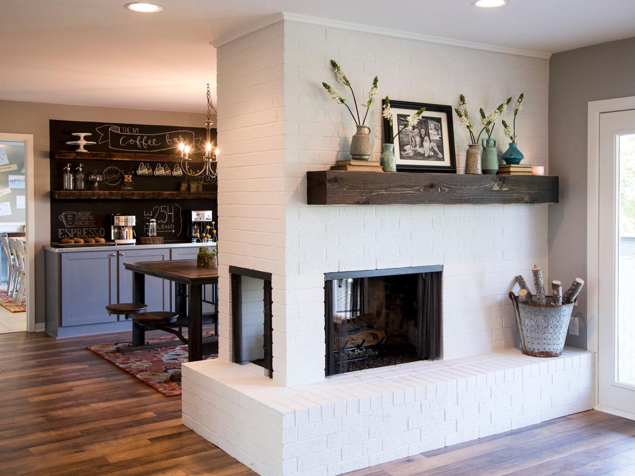 White Brick Fireplace With Wood Mantel