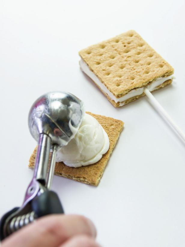 Use a medium cookie scoop leveled off to add marshmallow filling to half of a graham cracker.