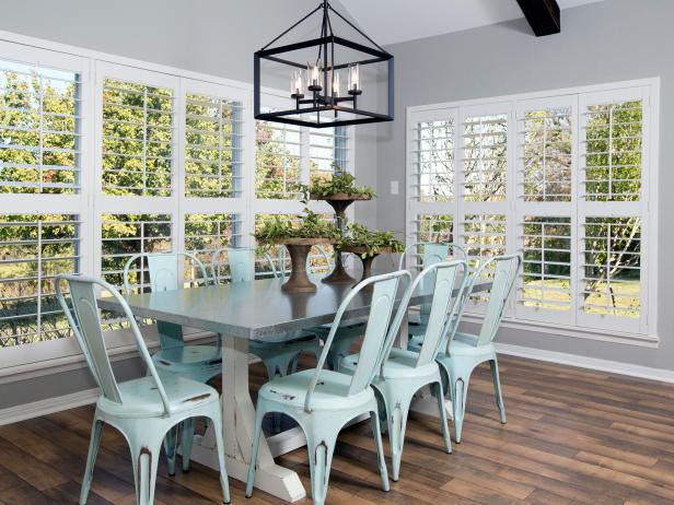 Gray Contemporary Dining Space With Blue Metal Chairs