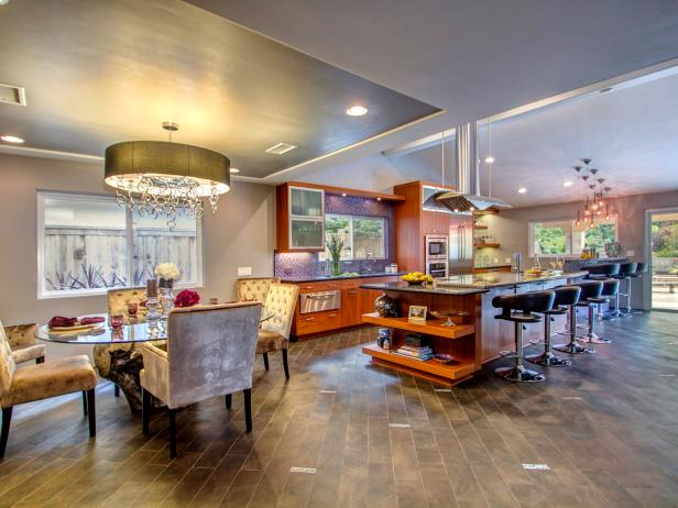 Open Kitchen and Dining Room With Wood-Look Tile and Oversized Island