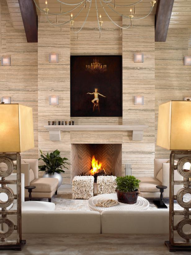 Neutral Living Room With Tile Fireplace, Chandelier and Neutral Chair